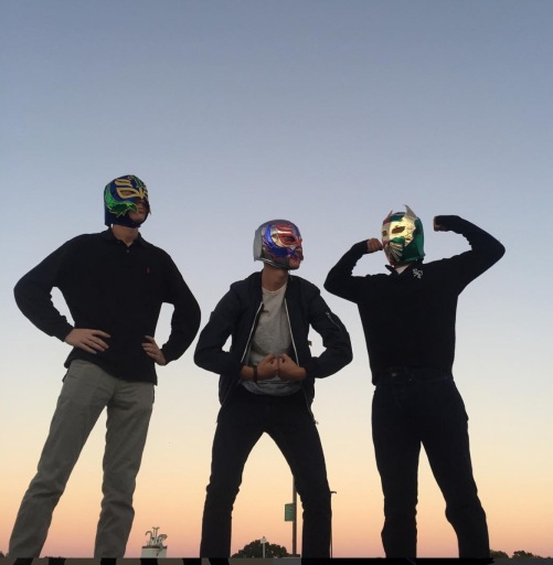 A pictures of 3 15 year old boys wearing masks on their faces
