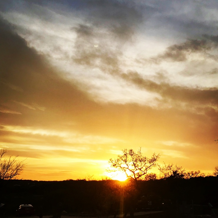 a picture of a yellow sunset and the setting sun